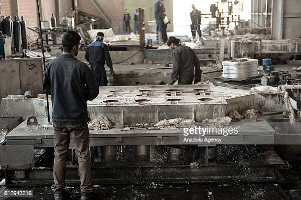 Iranian workers work at Alumroll Novin Aluminum Factory in Arak Iran on October 6 2016 Alumroll Novin Aluminum Factory employs 750 workers and...