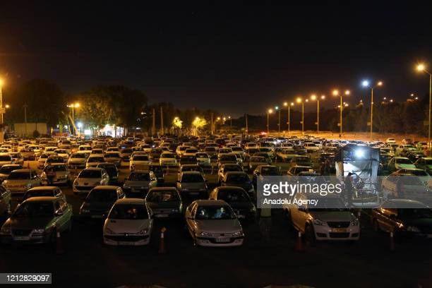 Iranian worshipers gather at Eram Park's parking area with their vehicles to pray amid coronavirus pandemic on the 19th day of Ramadan as eventual...