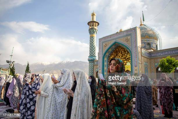 Iranian worshipers participate in Eid alFitr prayers at the Emamzadeh Panjtan shrine on May 24 2020 in Tehran Iran Iran has eased some lockdown...