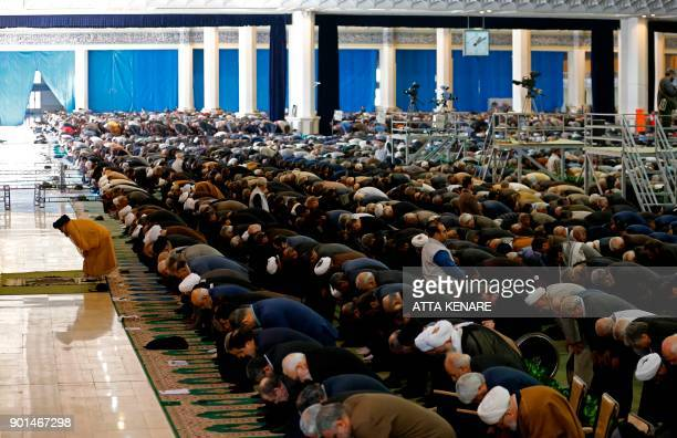 Iranian worshippers attend the friday prayers at the Imam Khomeini mosque in Tehran on January 5 2018 New proregime protests were held in Iran in...