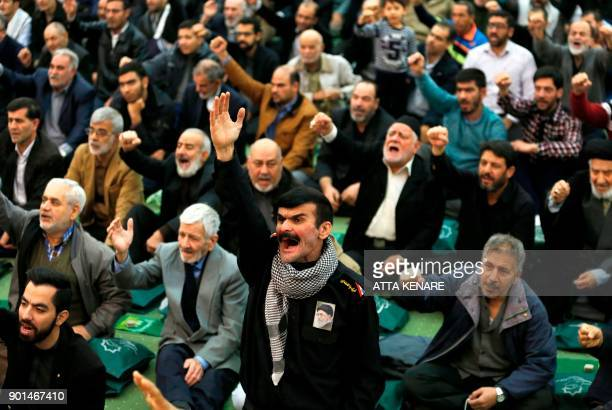 Iranian worshippers react to a speech during the friday prayers at the Imam Khomeini mosque in Tehran on January 5 2018 New proregime protests were...