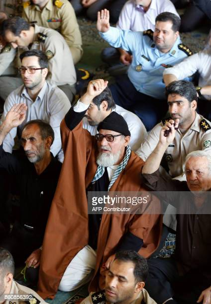 Iranian worshippers shout antiUS slogans during the weekly Friday prayer in Tehran on October 13 2017 President Donald Trump will unveil a more...