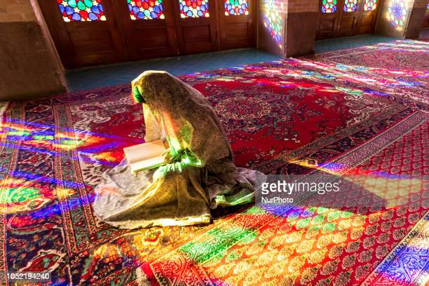 Iranian young woman read Quran in Nasir alMulk Mosque called the Pink Mosque as well in Shiraz Iran September 15 2018