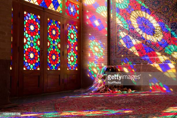 Iranian young women sit on a floor of Nasir al-Mulk Mosque, called the Pink Mosque as well, in Shiraz, Iran, September 15, 2018.