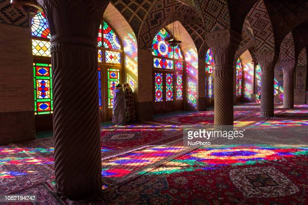 Iranian young women talk in Nasir al-Mulk Mosque, called the Pink Mosque as well, in Shiraz, Iran, September 15, 2018.