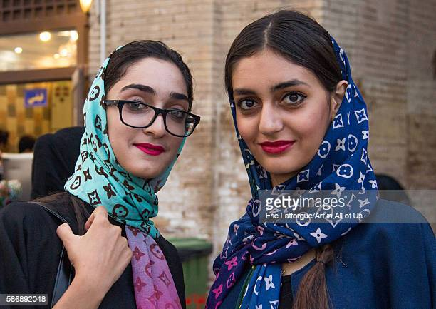 Iranian young women with louis vuitton scarves central district tehran Iran on September 7 2015 in Tehran Iran