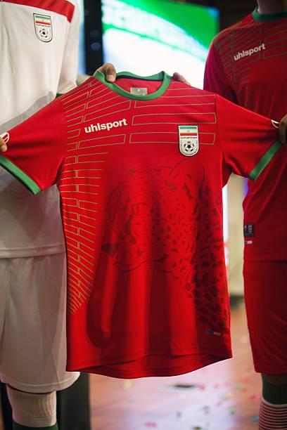 Iranian youth football players display the Iranian national football team  away jersey c9be8ab1b