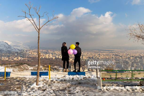 Iranian youths attend a birthday celebration at Bame Tehran on January 4 2020 in Tehran Iran
