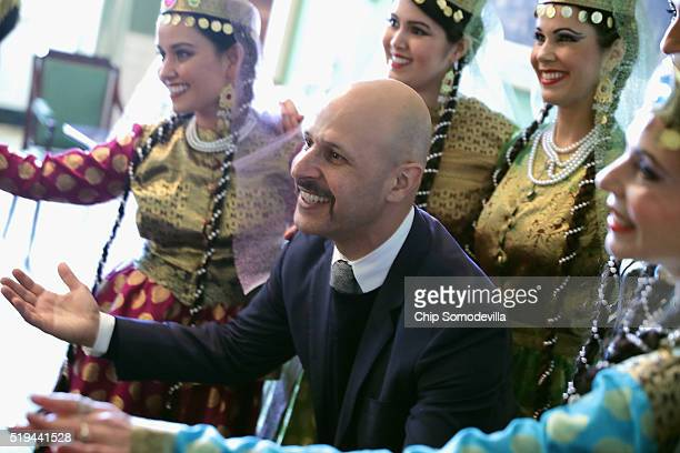 IranianAmerican comedian Maz Jobrani poses for photographs with members of the Nomad Dancers during a reception marking the Persian new year...
