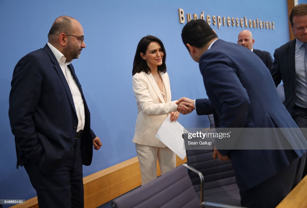 Iranian-born actress and human rights advocate Nazanin Boniadi (C) shakes hands with German politicians and Bundestag members Bijan Djir-Sarai (R) and Omid Nouripour (L) after speaking with them to the media on April 16, 2018 in Berlin, Germany. Boniadi, representing the U.S.-based Center for Human Rights In Iran, met with Bundestag members over possibilities for the German government to influence Iran towards improving its human rights conditions and policies. Boniadi is an actress and starred in the hit TV-series 'Homeland.'