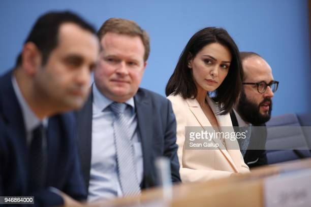 Iranianborn actress and human rights advocate Nazanin Boniadi sits with German politicians and Bundestag members Bijan DjirSarai and Frank Schwabe...