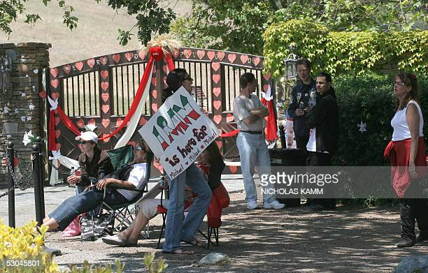 """Iranian-born fan Bita from Orange County, California, holds a sign reading """"Iran is here for Michael"""" in front of US pop star Michael Jackson's..."""