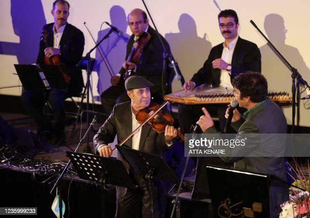 Iranians attend a concert on the opening day of the 38th Tehran International Short Film Festival in the Iranian capital on October 19, 2021 . -...