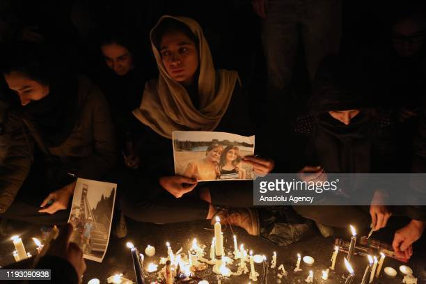 Iranians attend a vigil held for the victims of the airplane of Ukrainian International Airlines that crashed near Imam Khomeini Airport which later...