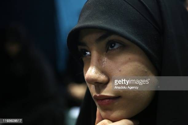 Iranians attend a vigil held for the victims of the airplane of Ukrainian International Airlines that crashed near Imam Khomeini Airport and Qasem...