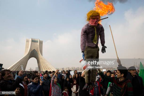 Iranians burn a Trump effigy as they celebrate the anniversary of the 1979 Islamic Revolution and denounce US President Donald Trumps recent...