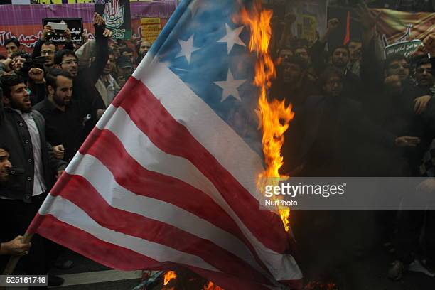 Iranians burn a US flag outside the former US embassy in the Iranian capital Tehran on November 4 during a demonstration marking the anniversary of...