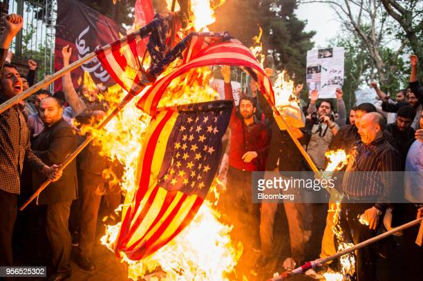 Iranians burn American flags during an antiUS demonstration outside the former US embassy headquarters in Tehran Iran on Wednesday May 9 2018 US...