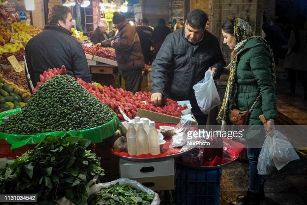 Iranians buy items to celebrate the upcoming Persian new year Noruz at Tajrish old bazaar in Tehran on March 08 2019 Iranians buy flowers green...