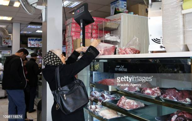 Iranians buy meat from a butcher's shop, in Tehran, Iran on February 12, 2019. Iran has been importing red meat primarily from Brazil, Australia and...