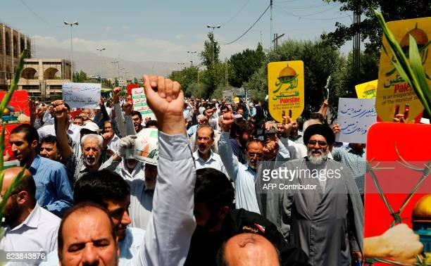 Iranians carry signs and chant slogans in support of the Palestian people at a demonstration after Friday prayers in the capital Tehran on July 28...