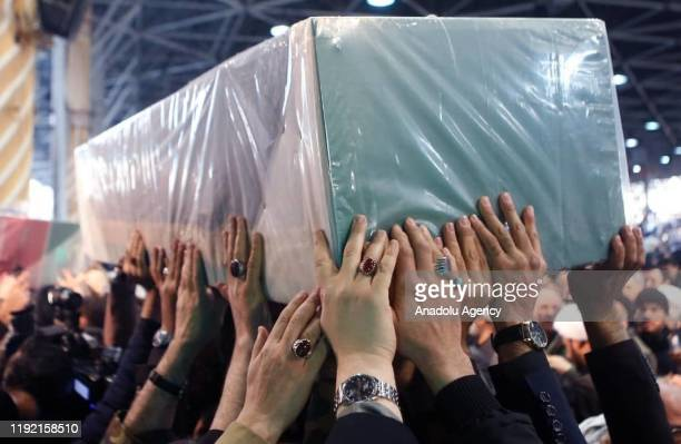 Iranians carry the casket of Qasem Soleimani commander of Iranian Revolutionary Guards' Quds Forces who was killed in a US drone airstrike in Iraq...