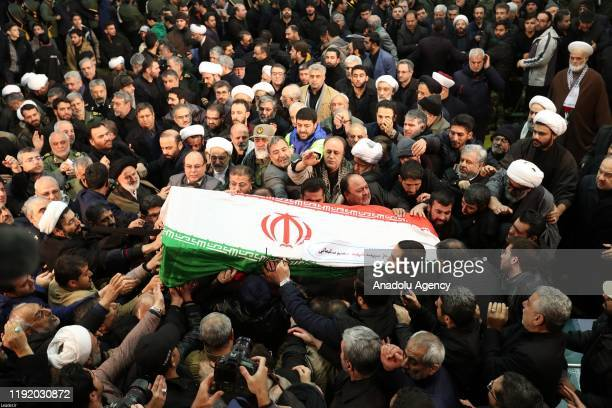 Iranians carry the coffin during the funeral ceremony of Qasem Soleimani, commander of Iranian Revolutionary Guards' Quds Forces, who was killed in a...
