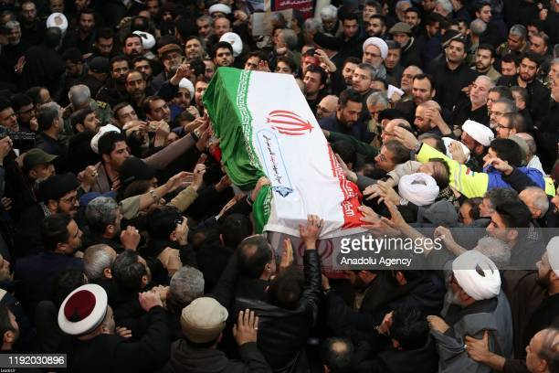 Iranians carry the coffin during the funeral ceremony of Qasem Soleimani commander of Iranian Revolutionary Guards' Quds Forces who was killed in a...