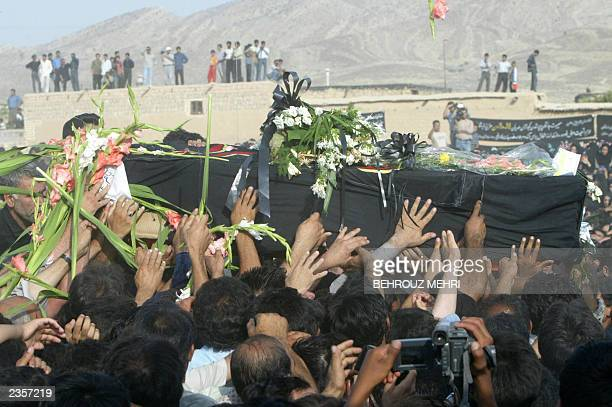 Iranians carry the coffin of Laleh Bijani one of the Iranian cojoined twins who died at the age of 29 on the operating table in Singapore in a failed...