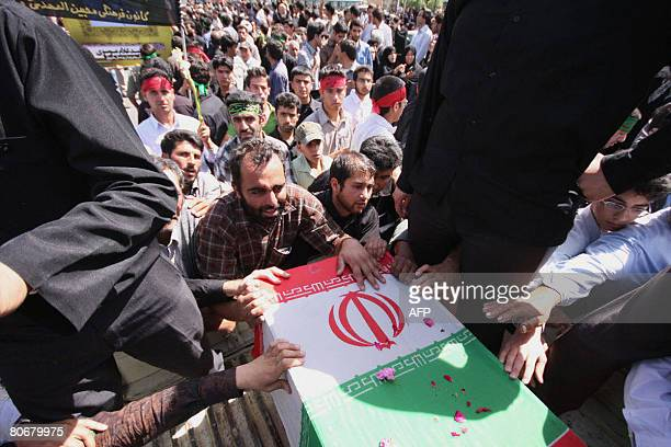 Iranians carry the coffins at Shah Cheragh shrine of Shiraz on April 15, 2008 during the funeral of the people who were killed in a mosque blast on...