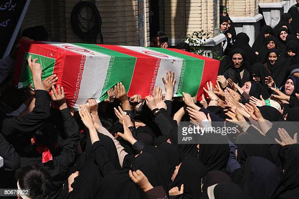 Iranians carry the coffins at the Shah Cheragh shrine of Shiraz on April 15, 2008 during the funeral of the people who were killed in a mosque blast...