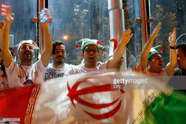 Iranians celebrate on the streets of Tehran early on June 13 after their national football team won the 2018 World Cup qualifying football match...