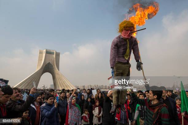 Iranians celebrate the anniversary of the 1979 Islamic Revolution and denounce US President Donald Trumps recent statements regarding the Muslim...