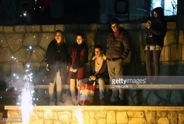 Iranians enjoy fire works in a park in Tehran on March 19 2018 during the Wednesday Fire feast or Chaharshanbeh Soori held annually on the last...