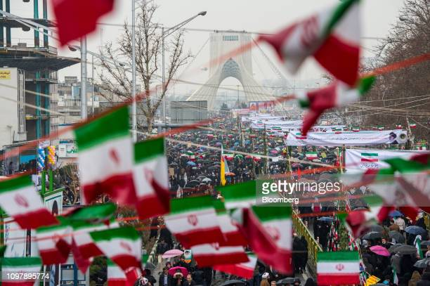 Iranians fill the street leading to the Azadi Tower during celebrations marking the 40th anniversary of the Islamic revolution in Tehran, Iran, on...