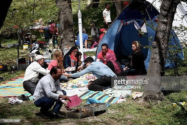 Iranians gather at a park in northern Tehran on April 2 2013 as they celebrate Sizdah Bedar on the 13th day of Noruz which people spend outdoors to...