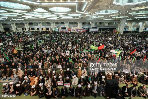 Iranians gather in support of the government at the Imam Khomeini grand mosque in the capital Tehran on December 30 2017 Tens of thousands of regime...