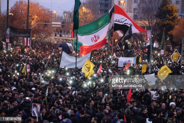 Iranians gather in the northeastern city of Mashhad on January 5 2020 to pay homage to top general Qasem Soleimani and others after they were killed...