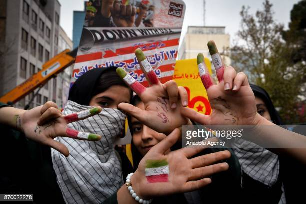 Iranians gather outside the former US embassy in the Iranian capital Tehran on November 4 during a demonstration marking the anniversary of its...