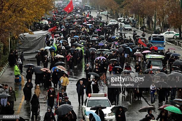 Iranians gathered at Imam Hossein Square walk towards the ShahAbdolAzim Shrine during the Arba'een ceremony in Tehran Iran on December 2 2015...
