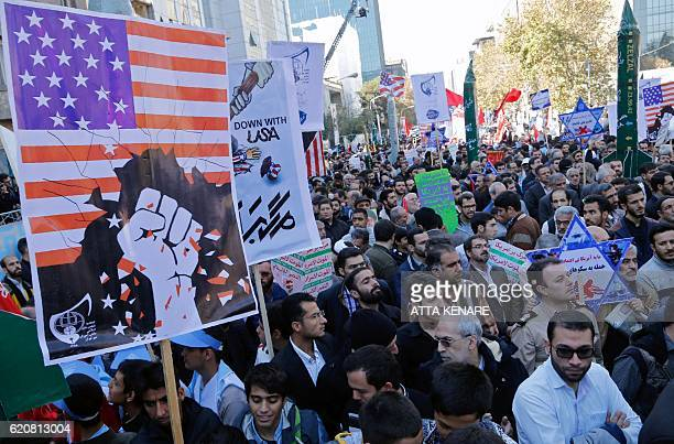 Iranians hold anti-America banners outside the former US embassy in the Iranian capital Tehran on November 3 during a demonstration marking the...