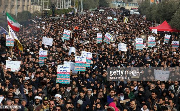 TOPSHOT Iranians hold antiUS banners during a demonstration in the capital Tehran on January 3 2020 following the killing of Iranian Revolutionary...
