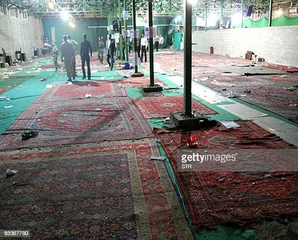 Iranians inspect the site of an explosion inside a mosque in the southern city of Shiraz, 950 kms south of Tehran, on April 12, 2008. Eleven people...