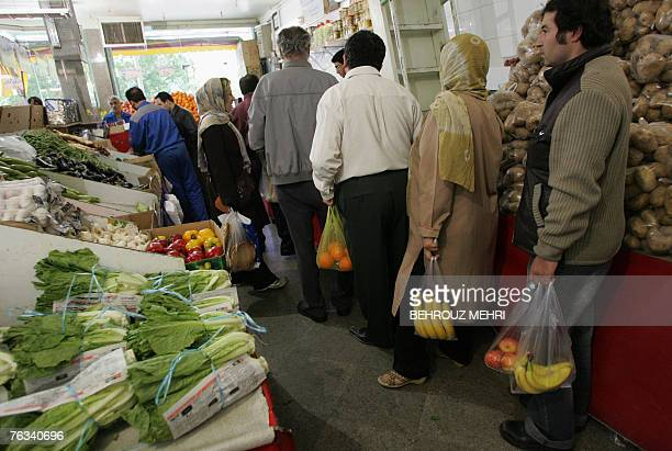 Iranians line up to pay for their purchase in a grocery store in downtown Tehran 22 April 2007 With the world's eyes focused on its nuclear programme...