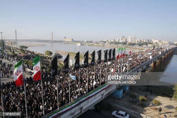TOPSHOT Iranians march on January 5 2020 in the streets of the northwestern city of Ahvaz to pay homage to top general Qasem Soleimani after he was...