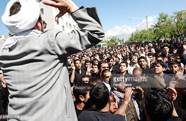 Iranians mourn the dead at a ceremony coinciding with a Shiite holy day 12 years after the end of IranIraq war and up to the start of Coalition war...