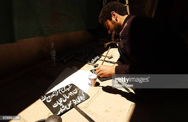 Iranians prepare to bury the dead at a ceremony coinciding with a Shiite holy day 12 years after the end of IranIraq war and up to the start of...