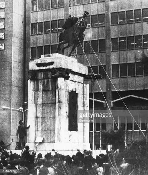 Iranians pull down a statue of Reza Shah Pahlavi after his son, Mohammed Reza Shah Pahlavi leaves the country.