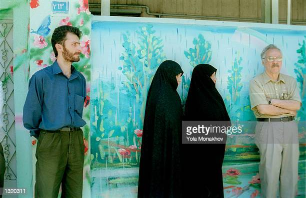 Iranians queue up to vote in the presidential election at a polling station June 8, 2001 in northern Tehran, Iran. President Mohammad Khatami, who is...