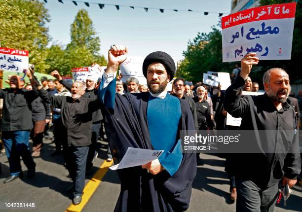 Iranians raise anti-US signs and chant slogans as they march during a demonstration following the weekly Muslim Friday prayer in the capital Tehran...